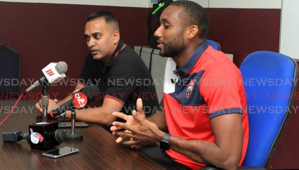 T&T footballer Adrian Foncette (right) speaks to the media during a press conference at the Police Grounds, St James on Friday. Also in photo is TTFA communications manager Shaun Fuentes. PHOTO BY AYANNA KINSALE. - Ayanna Kinsale