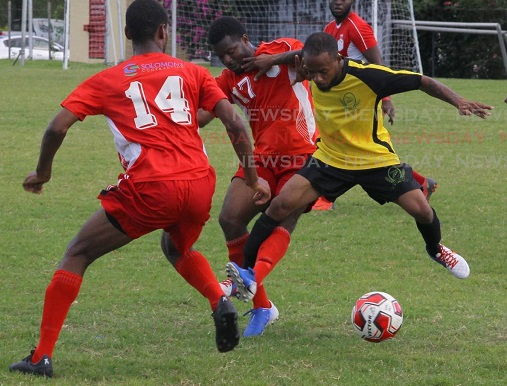 Osaze Springer (R), of RSSR FC, and Bethel United's Ackel Carrington (17) vie for the ball during a Super League encounter, at the Hasely Crawford Stadium,on Sunday. - ROGER JACOB