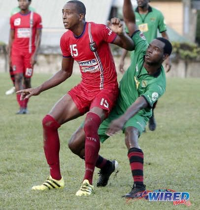 Photo: Morvant Caledonia AIA attacker Johnny Noreiga-Brito (left) awaits a pass while San Juan Jabloteh player Delon Jagassar during Ascension Invitational action at Bourg Mulatresse on 28 July 2019. (Copyright Annalicia Caruth/Wired868)