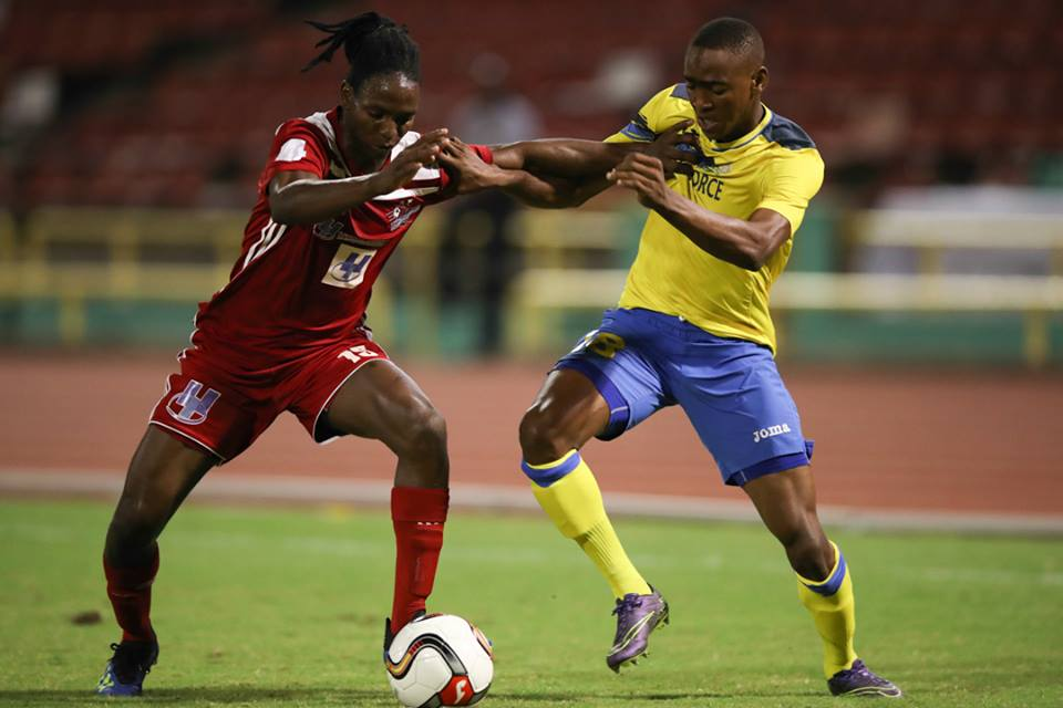 Central FC's Kaydion Gabriel, left, and Defence Force FC winger Reon Moore vie for the ball during the First Citizens Cup final at the Hasely Crawford Stadium on Jul. 20, 2018. (Courtesy First Citizens/CAI/Allan V. Crane)