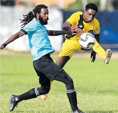 Cunupia FC's Michael Darko, right, attempts to get pass QPCC's Yohance Marshall on Matchday 7 of the T&T Super League at St Mary's College Grounds, St Clair, on Sunday. QPCC won 2-1. PICTURE CA-IMAGES