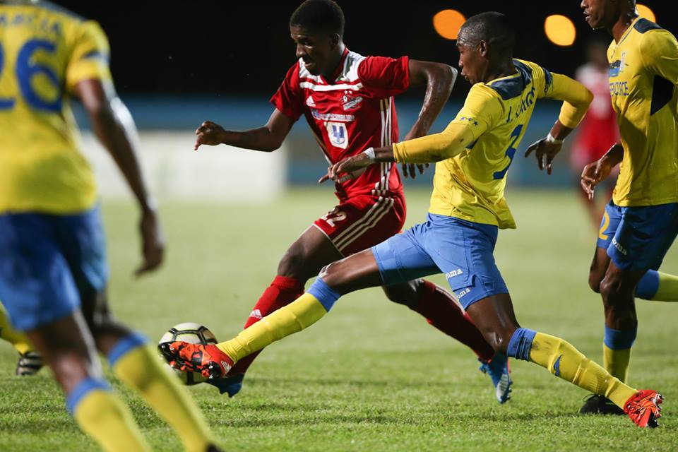 Photo: Defence Force defender Jamali Garcia (#3) tries to stop a run by Central FC's Jameel Neptune during their group stage clash of the First Citizens Cup at Ato Boldon Stadium on Jun. 22, 2018. (Courtesy First Citizens/CAI/Allan V. Crane)