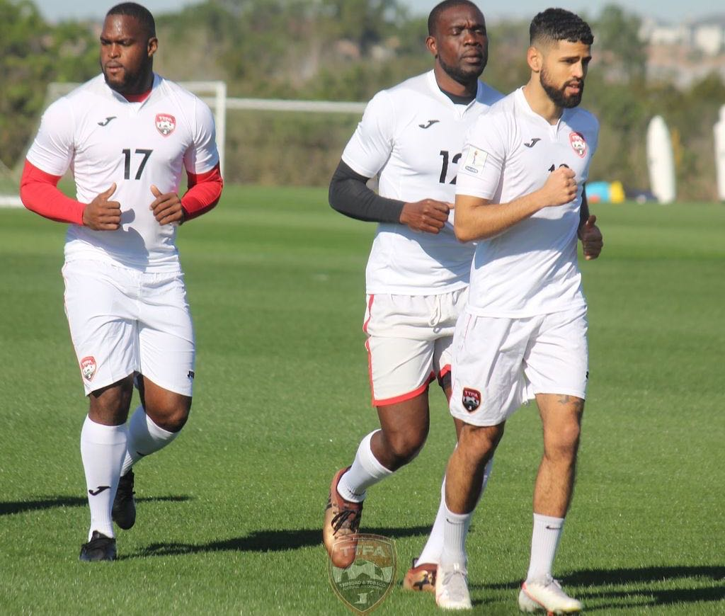 Canadian-based midfielder and full-back Federico Pena, right, lead the team in a warm-up session on Saturday at the team's base in Orlando, Florida, USA. T&T will face the United States in an international friendly at Exploria Stadium in Orlando on Sunday from 8:30 pm TT Time. ...Courtesy TTFA
