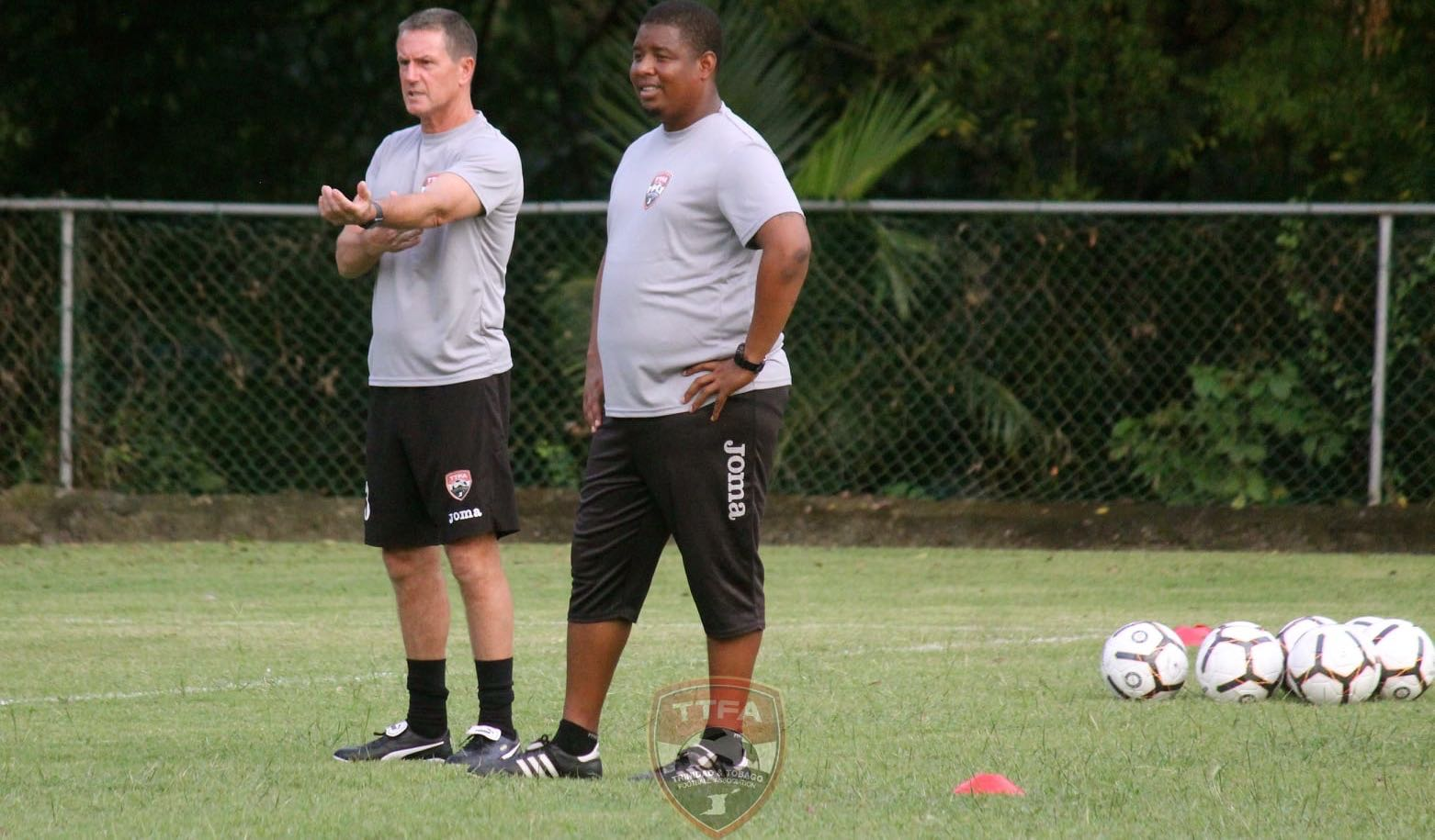 T&T head coach Terry Fenwick (left) and assistant coach Derek King