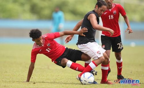 Photo: Attacker Gary Griffith III (left) tackles midfielder Gabriel Nanton during Men's National Senior Team training on 17 July 2020 at the Ato Boldon Stadium, Couva. (Copyright Allan V Crane/CA-Images/Wired868)