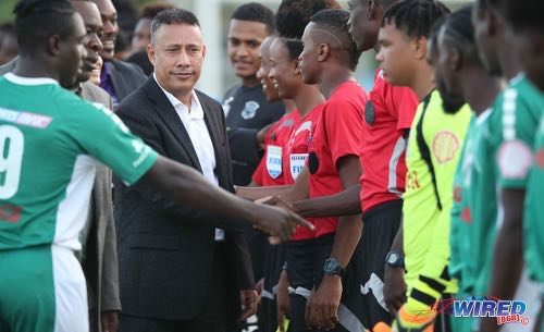 Photo: Commissioner of Police Gary Griffith (centre) meets the San Juan North Secondary players before kickoff of the National Intercol final at the Ato Boldon Stadium on 4 December 2018. (Copyright Allan V Crane/CA-Images/Wired868)