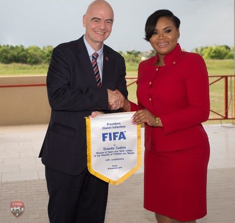 Photo: Fifa president Gianni Infantino (left) presents Minister of Sport Shamfa Cudjoe with a token during the opening of the TTFA Home of Football in Couva on 18 November 2019. (Courtesy Allan V Crane/TTFA Media)