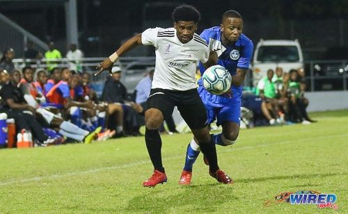 Photo: La Horquetta Rangers flanker Aikim Andrews (left) tries to evade Police FC left back Clevon McFee during the First Citizens Cup final at the Diego Martin Sporting Complex on 6 December 2019. (Copyright Sean Morrison/Wired868)