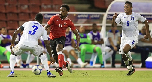 T&Ts Levi Garcia (11) tries to get past Honduras' Maynor Figueroa during their CONCACAF Nations League matchup at the Hasely Crawford Stadium, Mucurapo, on Thursday night. Honduras won 2-0. - CA-images