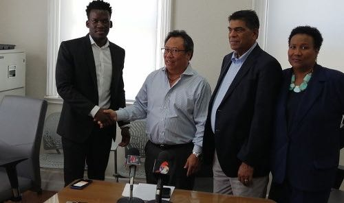 Photo: League Commission chairman Lindsay Gillette (second from left) shakes hands with TTFA general secretary Camara David (far left) while members Anthony Harford (second from right) and Julia Baptiste look on on 21 May 2019. (Copyright TTFA Media)