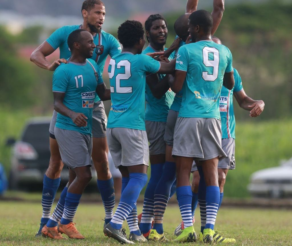 Morvant Caledonia AIA players celebrate a goal during the Ascension Invitational match against Club Sando at the Mannie Ramjohn Stadium in Marabella on Sunday.