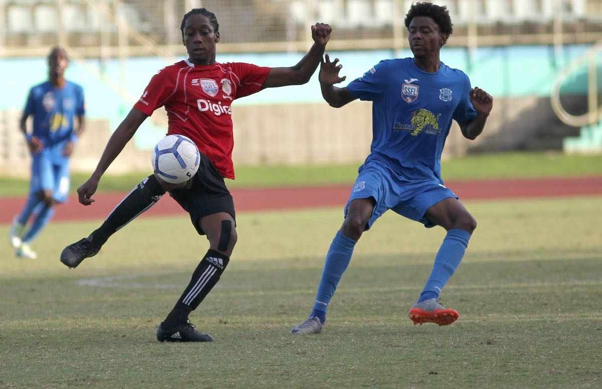 St Anthony's Quinn Fredrick,left, and Naparima College's Isa Bramble, vie for the ball during the semi-final encounter yesterday, at the Manny Ramjohn Stadium, Marabella. Naps won 2-0.