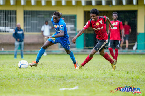Photo: Naparima College forward Isa Bramble (left) runs at the St Anthony's College defence during SSFL action at Westmoorings on 9 October 2019. (Copyright Daniel Prentice/CA-Images/Wired868)