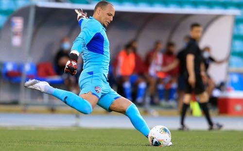 Photo: Trinidad and Tobago goalkeeper Nicklas Frenderup takes a goalkick during World Cup qualifying action in Mayaguez on 28 March 2021. (via TTFA Media)