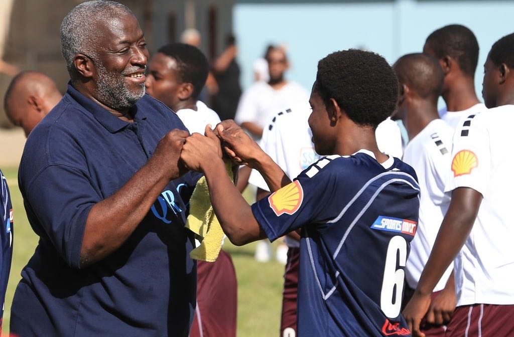 WELL DONE Coach Nigel Grosvenor shows his appreciation for the effort of one of his players during Round 1 of the 2019 SSFL match between QRC and East Mucurapo Secondary at QRC Grounds, St. Clair. The match ended 2-2.  Allan V. Crane