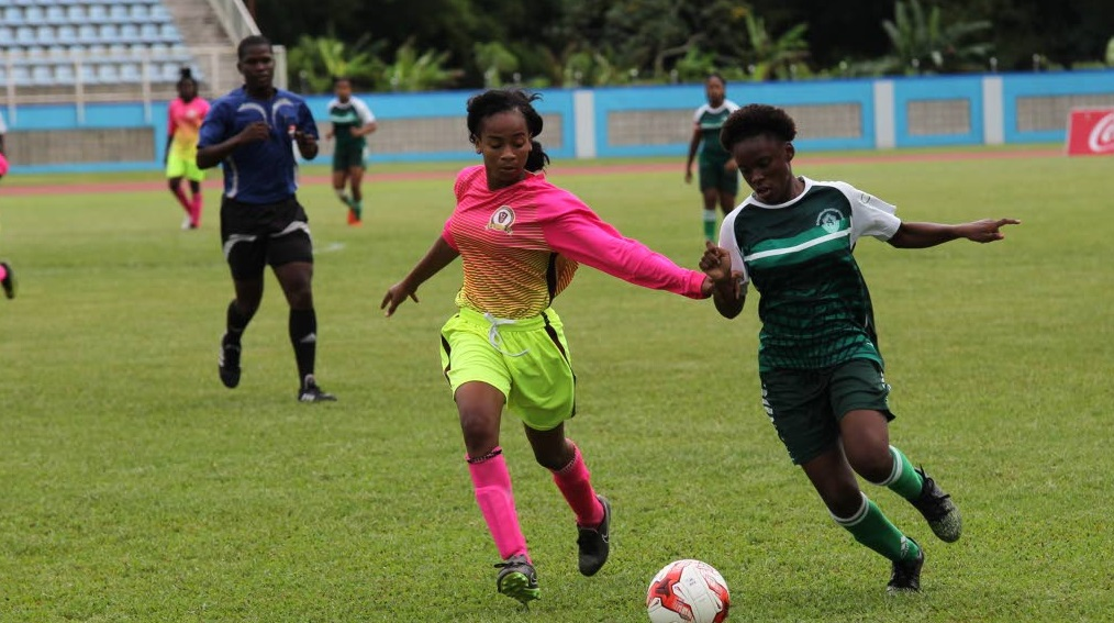 Pleasantville Secondary's Kayla Maillard, left, battles St Augustine Secondary's Mya Hernandez in the First Citizens National Girls Big 5 final at the Ato Boldon Stadium, Couva, yesterday.