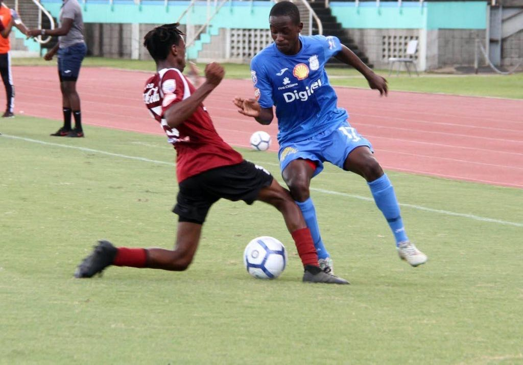 Matthew Hezron of Pleasantville Secondary,left, and Naparima College's Nathaniel Perouse battle for the ball during the SSFL match held at Mannie Ramjohn Stadium, Marabella,yesterday.