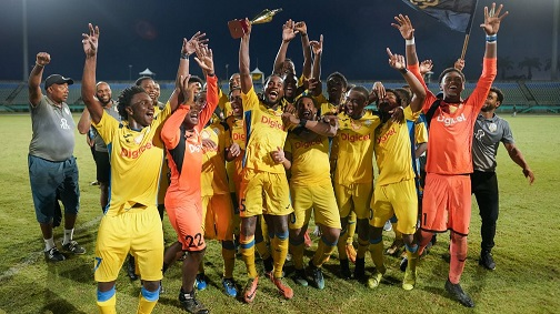 Presentation College players and coaching staff celebrate their South Zone Coca Cola Intercol win over Naparima College at the Mannie Ramjohn Stadium in Marabella yesterday. Presentation won 4-3 on penalties after a 1-1 draw. ...Daniel K. Prentice/CA-images