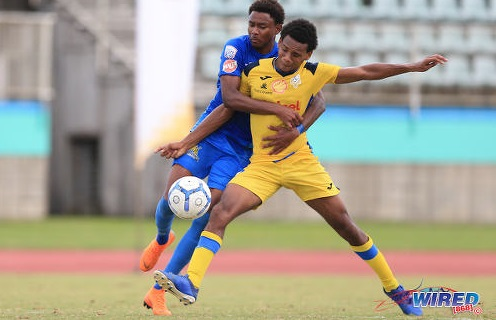 Photo: Presentation (San F'do) defender Nigel Caraby (right) tries to hold off Naparima attacker Seon Shippley during SSFL action in Marabella on 23 October 2019. (Copyright Allan V Crane/CA-Images/Wired868)