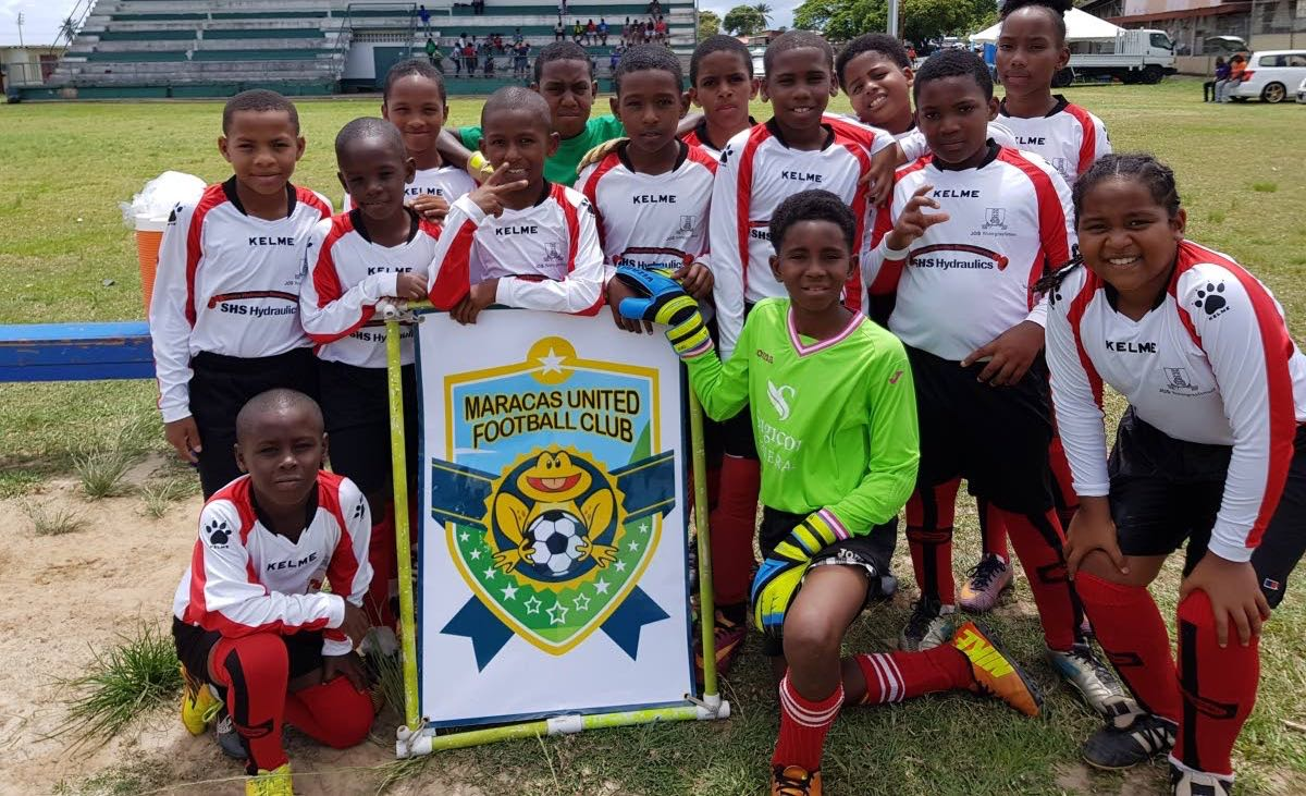 SWEET VICTORY: Maracas United FC players enjoy their first win of the Republic Youth Football League on Saturday at Constantine Park, Macoya.