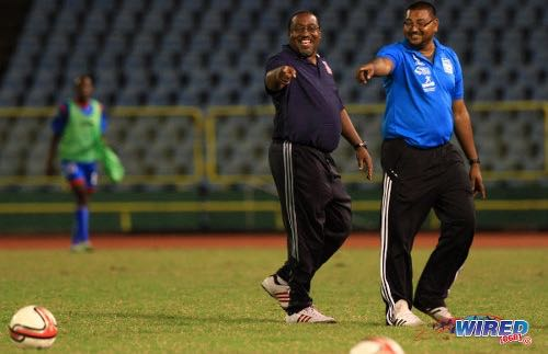 Photo: Morvant Caledonia United co-founder and head coach Jamaal Shabazz (left) and then assistant coach Rajesh Latchoo enjoy a good day at the office during the 2013/14 Pro League season. (Courtesy Allan V Crane/Wired868)