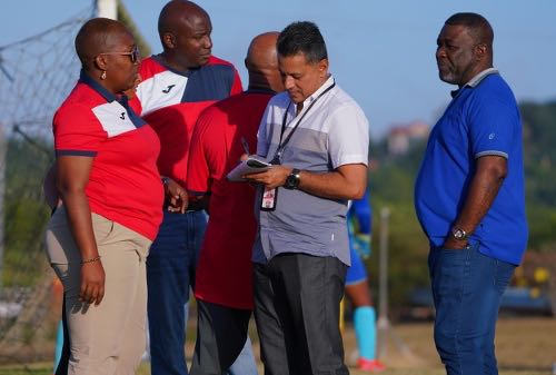 Photo: TTFA president William Wallace (far right), general secretary Ramesh Ramdhan (second from right) and technical director Dion La Foucade (second from left) talk to Women's U-20 Team manager Maylee Attin-Johnson during practice at the Ato Boldon Stadium training field in Couva on 7 February 2020. (Copyright Daniel Prentice/Wired868)