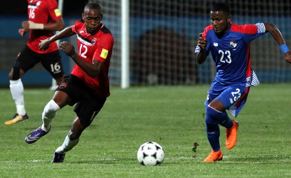 T&T's Reon Moore,left, and Panama's Sergio Ortega vie for the ball during an international friendly, on Tuesday, at the Ato Boldon Stadium. Panama won 1-0. PHOTO BY ANSEL JEBODH