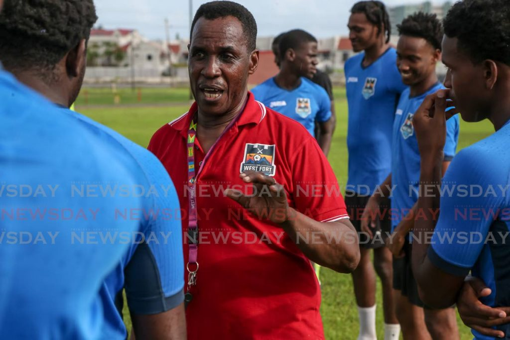 Real West Fort United owner/coach Ron La Forest (centre) talks to his players during a training session at the Corporate Ground, Westmoorings on Saturday. PHOTO BY JEFF MAYERS. - Jeff Mayers