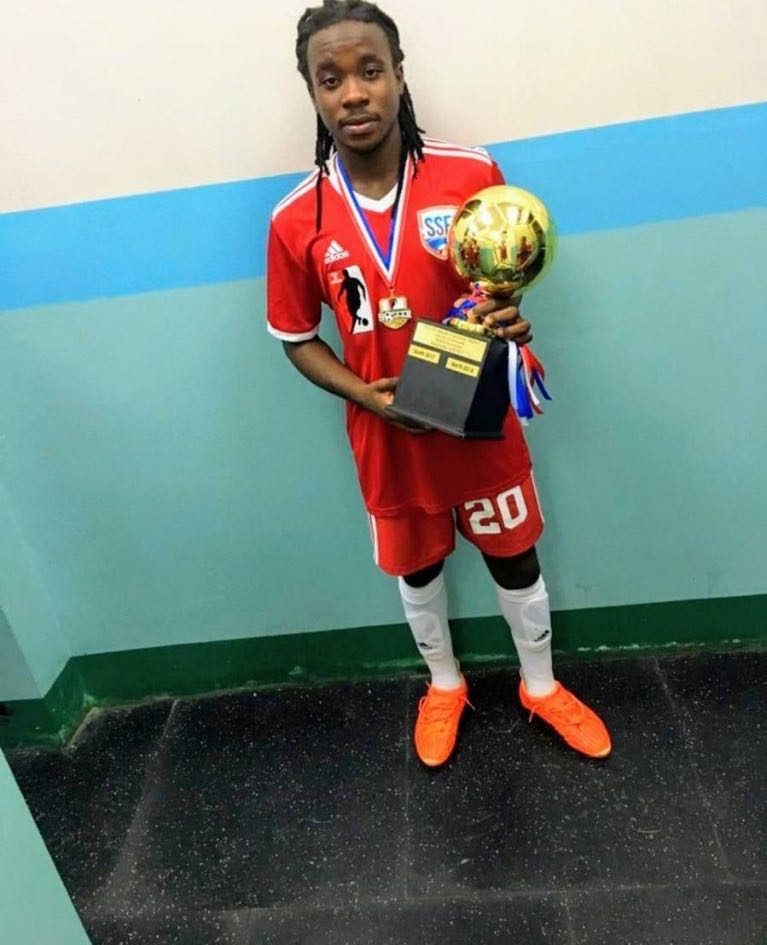 Ronaldo Jacob, poses with a trophy he won for being the player of a match after his North-South Classic football tournament at the Manny-Ramjohn stadium. PHOTO COURTESY RONALDO JACOB - RONALDO JACOB