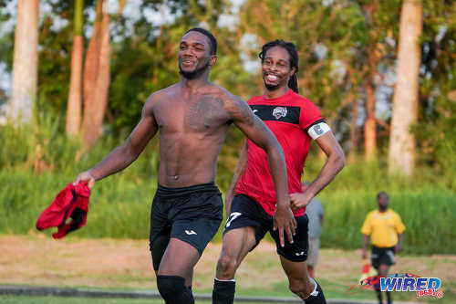 Photo: San F'do Giants midfielder Yohannes Richardson (left) celebrates his decisive penalty kick with captain Odell Fitzallen during Ascension action against Deportivo PF at the Mannie Ramjohn Stadium Training Field on 29 September 2019. (Copyright Daniel Prentice/CA-Images/Wired868)