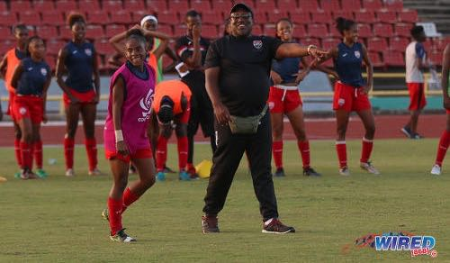 Photo: Trinidad and Tobago Women's National Under-20 coach Jamaal Shabazz (right) instructs attacker Aaliyah Prince during practice at the Hasely Crawford Stadium on 9 January 2018. ...(Courtesy Sean Morrison/Wired868)