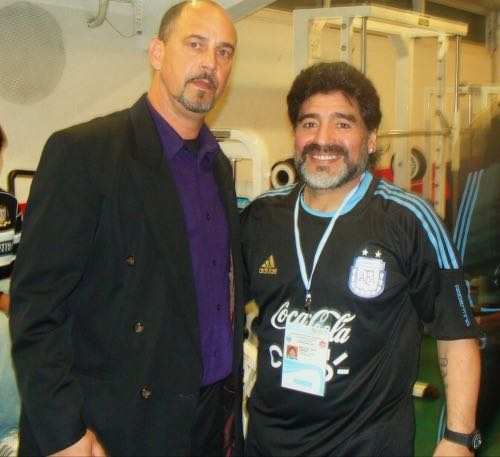 Photo: Then Canada head coach Stephen Hart (right) poses with Argentina coach Diego Maradona after an international friendly on 24 May 2010. Argentina won 5-0 against an under-strength Canada team.