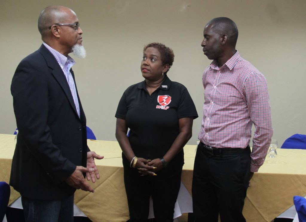 President of the TT Super League and board member of the TT Football Association (TTFA) Keith Look Loy, left, chats with president of the TT Women's League Football (WoLF) Susan Joseph-Warrick and board member of the Northern Football Association secretary Rayshawn Mars,right, at a press conference , held at the Hotel Normandie, yesterday. - AYANNA KINSALE