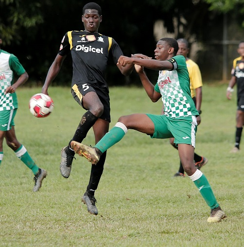 St Augustine player Jamal Ollivere, right, vies for the ball with Trinity College Moka's Jahiem Marshall during the Secondary School Football League Premiership Division at St Augustine School Grounds on October 22. Trinity Moka won 3-1. ...ABRAHAM DIAZ
