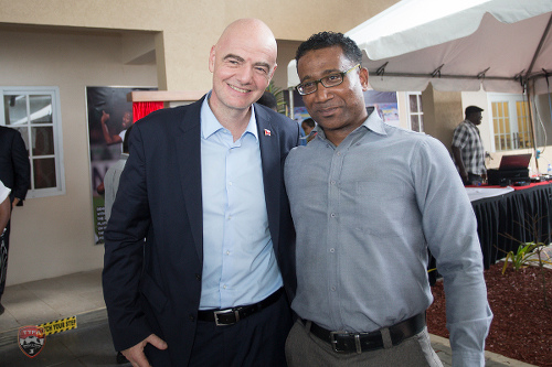 Photo: TTFA finance officer Tyril Patrick (right) poses with Fifa president Gianni Infantino during the opening of the TTFA Home of Football on 18 November 2019. (Courtesy Allan V Crane/TTFA Media)