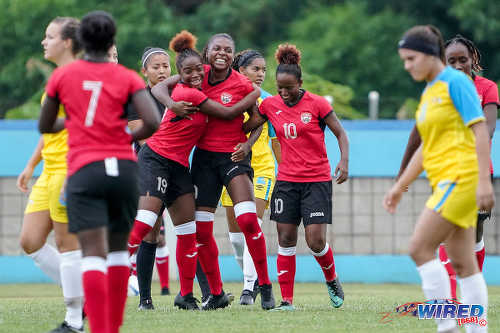 Photo: Trinidad and Tobago goal scorer Nia Walcott (centre) is congratulated by teammates during Olympic qualifying action against Aruba in Couva on 30 September 2019.