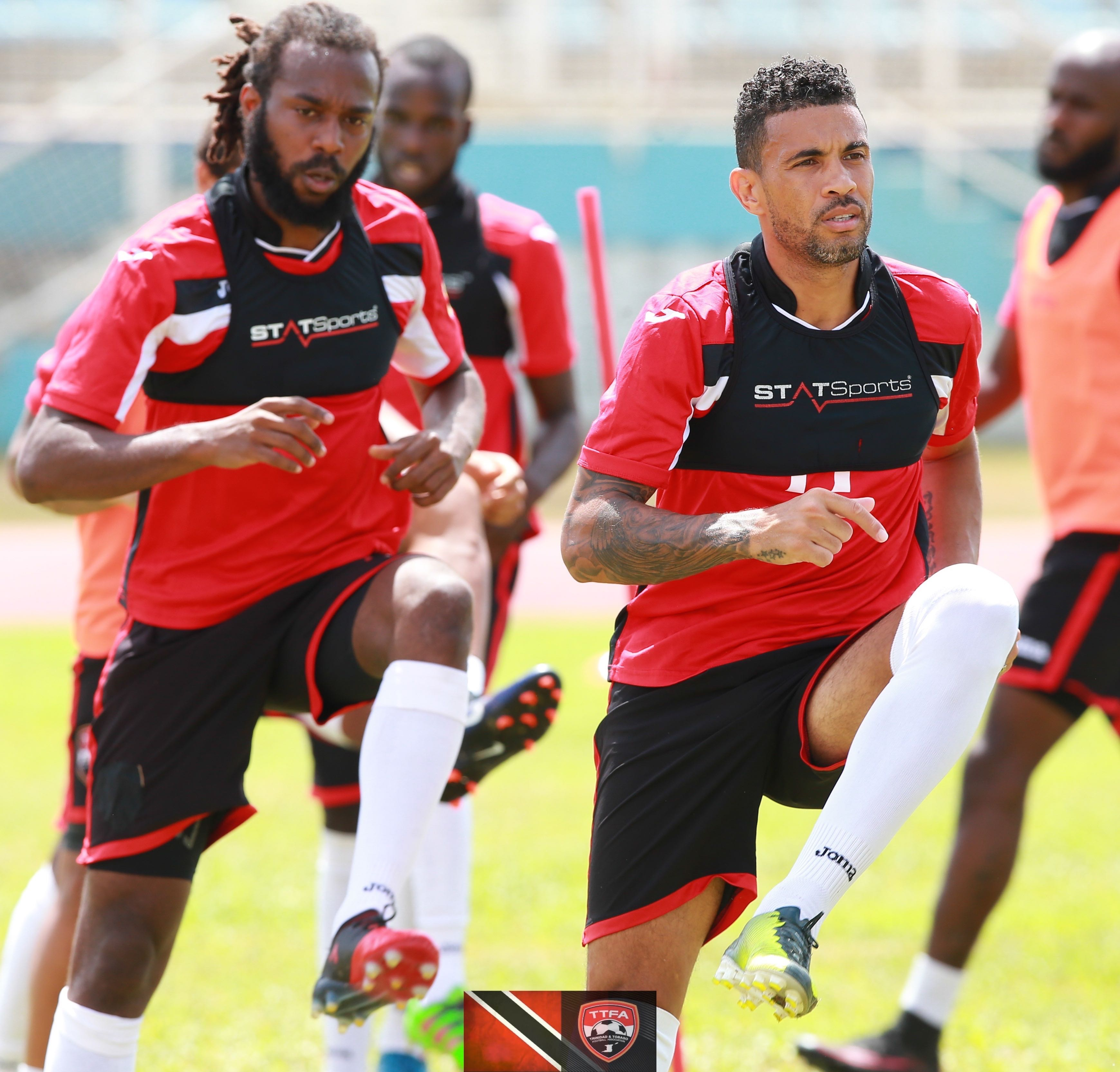Super League MVP Marshall (left) and Carlos Edwards (right) training with T&T national football team.