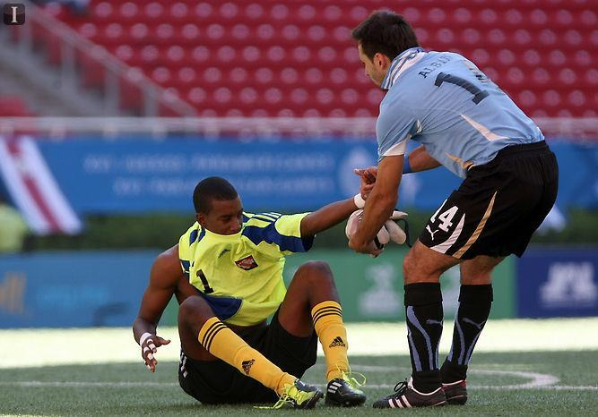 goalkeeper Andre Marchan being helped by player from Uraguay