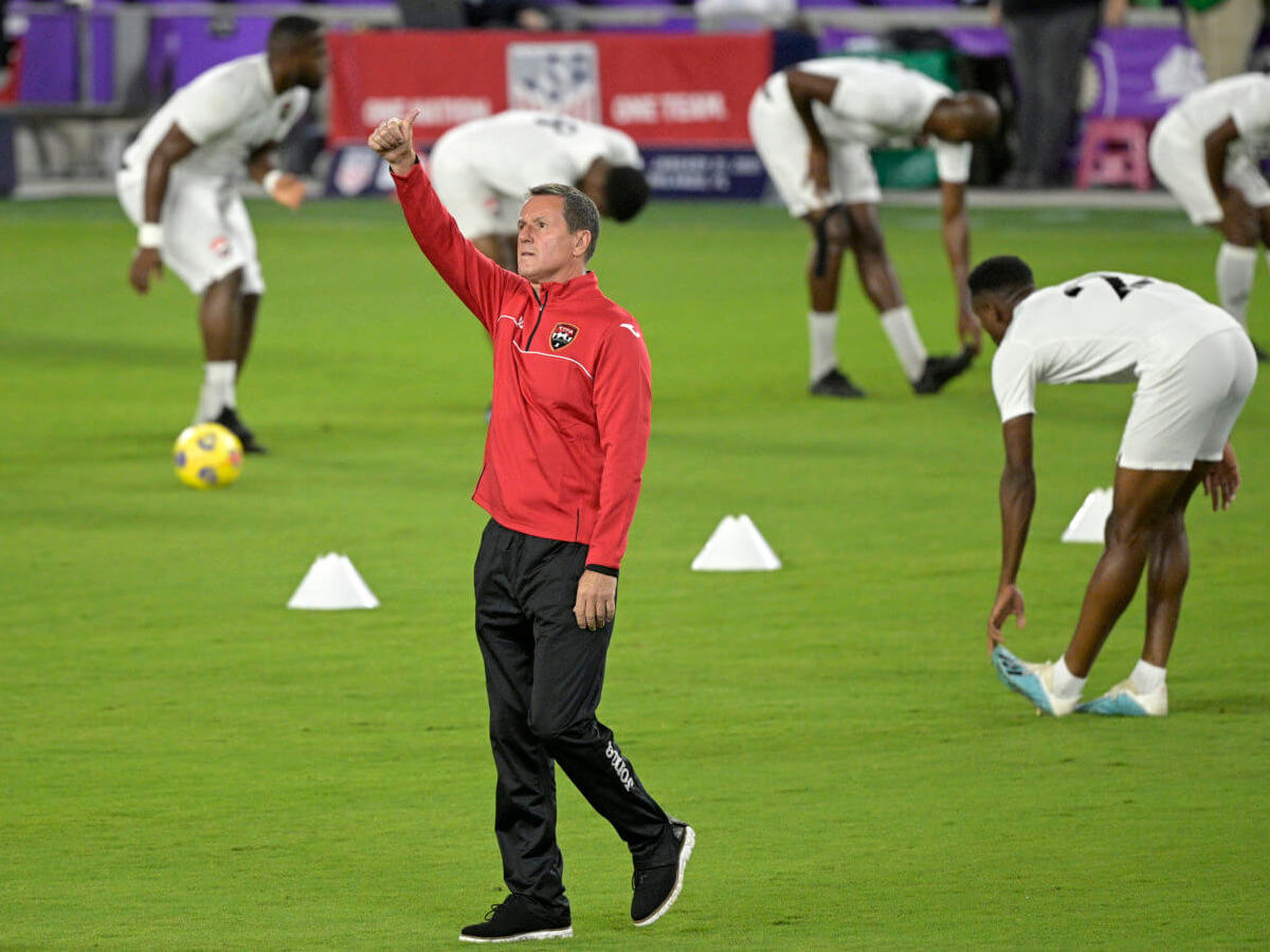 Trinidad and Tobago head coach Terry Fenwick acknowledges fans in the stands during warmups before an international friendly soccer match against the United States, Sunday, Jan. 31, 2021, in Orlando, Fla.  (Associated Press/Phelan M. Ebenhack)