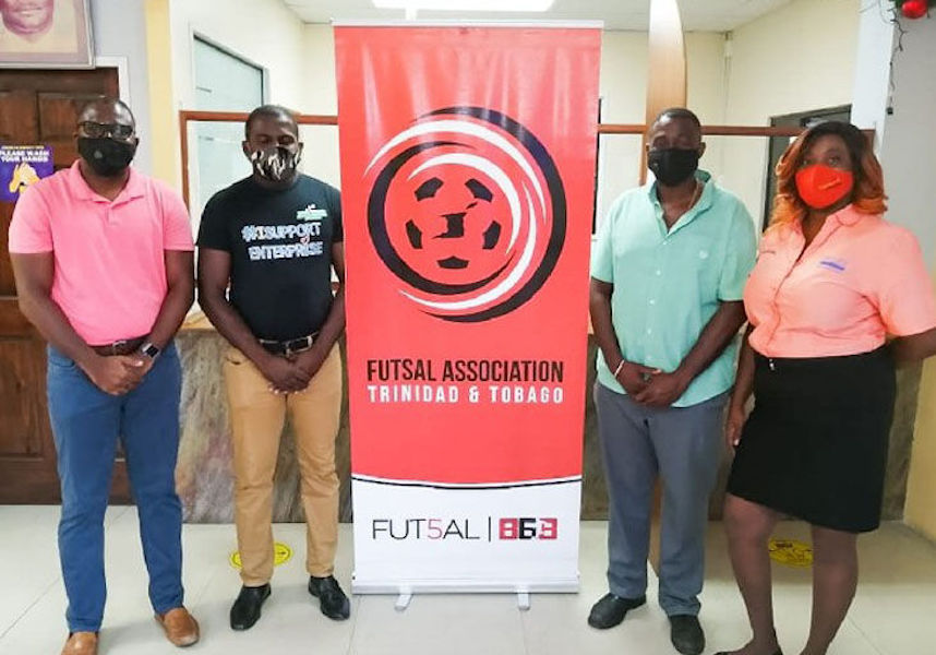 COLLABORATIVE EFFORT: Geoffrey Edwards, Futsal president, from left, Justin Lewis, Dass Trace Youth Empowerment Committee president, Enterprise businessman Sean Regis and Ginelle Small-Cummings, chairman, Jimroy Wyse Committee.