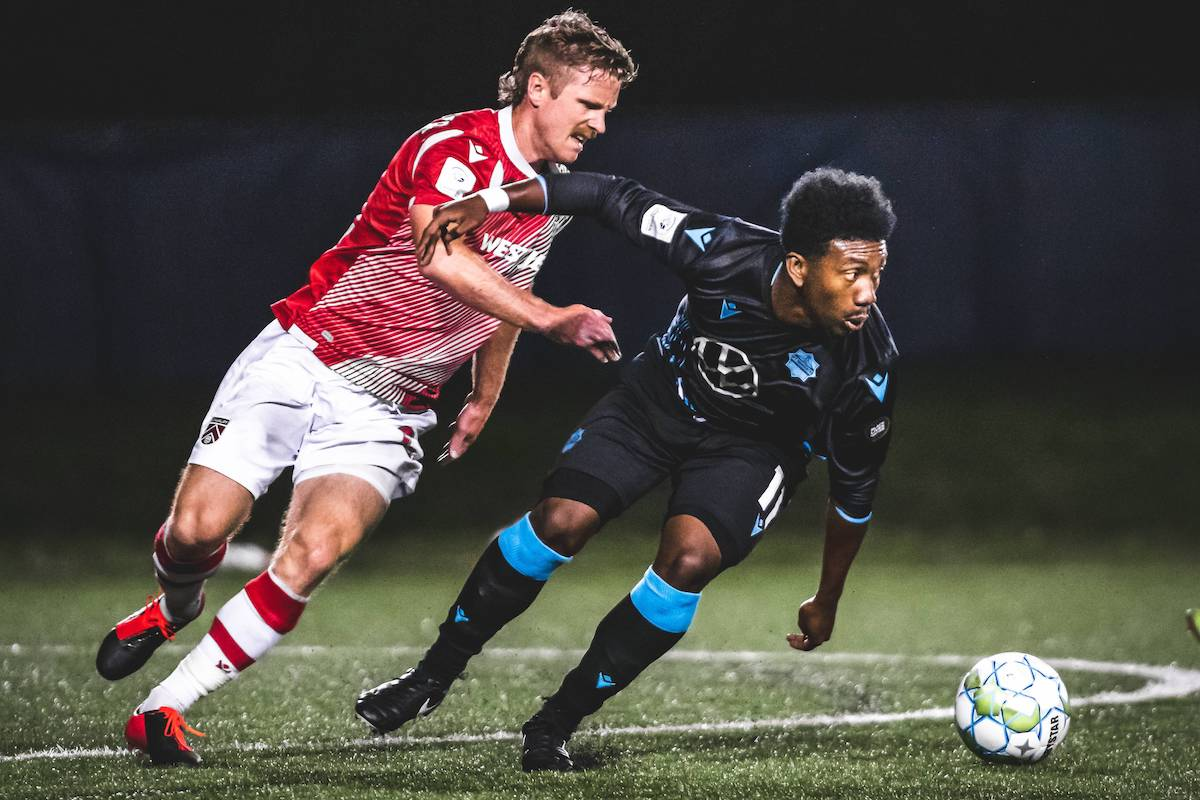 HFX Wanderers striker Akeem Garcia (right) breaks away from a Cavalry FC defender during a 2020 Canadian Premier League match at the Island Games in Charlottetown, Prince Edward Island