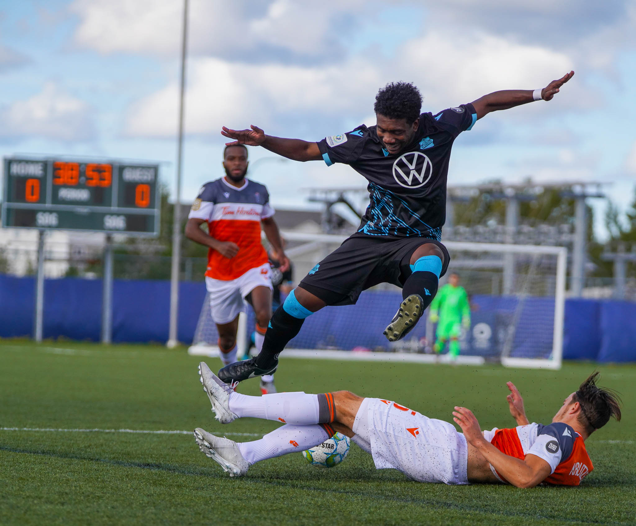 HFX Wanderers attacker Akeem Garcia evades a tackle from Forge FC's Daniel Krutzen. (CPL/Chant Photography)
