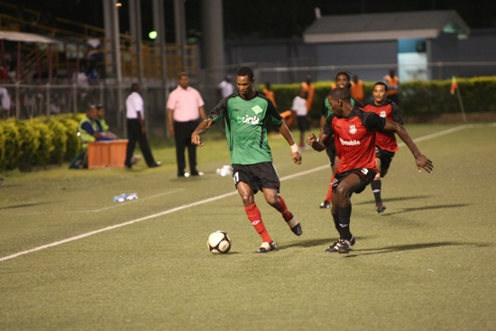 Jabloteh midfielder Ataullah Guerra takes on Joe Public defender Keion Goodridge during Big Six action. Guerra wasn't really in the mood last night though.