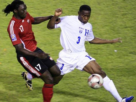 Kenwyne Jones battles on with Honduras defender Figueroa