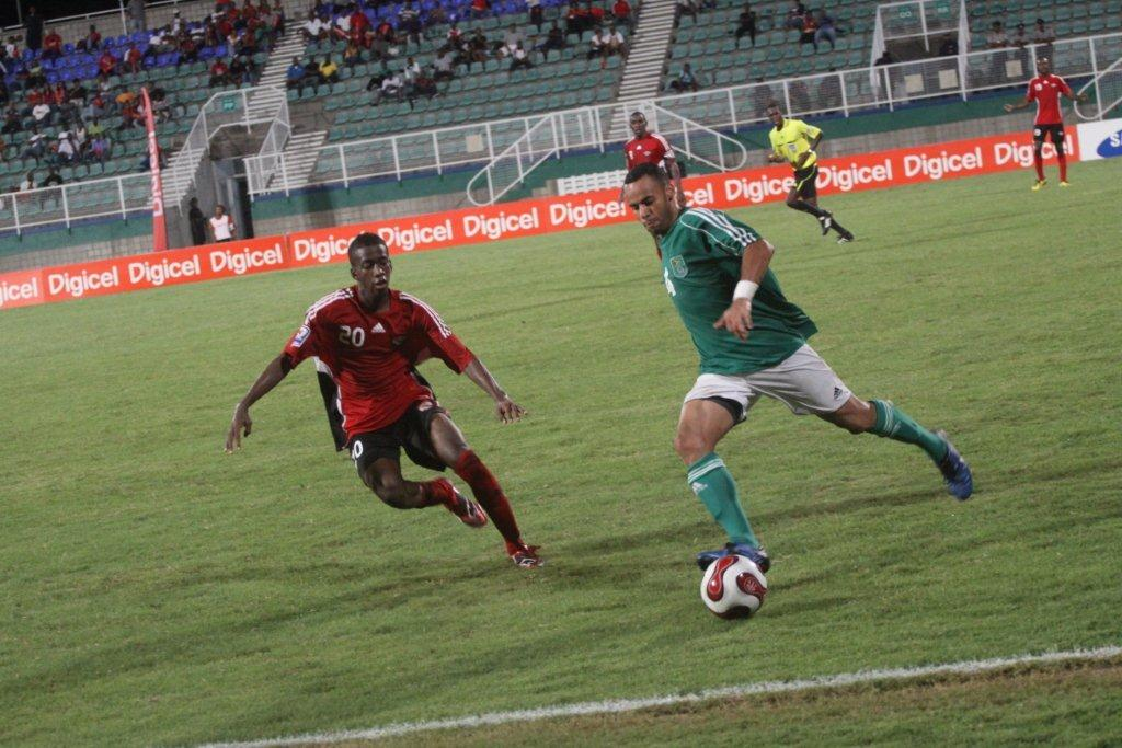 Kevin Molino (left) vs Guyana.