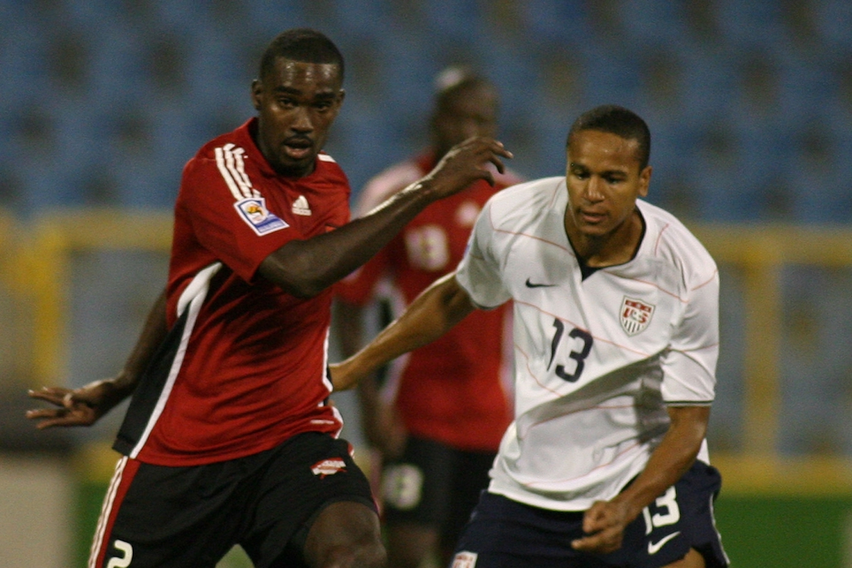 PORT OF SPAIN, TRINIDAD AND TOBAGO - SEPTEMBER 09: Clyde Leon (L) of Trinidad Tobago fights for the ball with Ricardo Clark of United States during their FIFA 2010 World Cup North, Central America and Caribbean qualifier at the Hasely Crawford Stadium on September 9, 2009 in Port Of Spain, Trinidad and Tobago. (Photo by Anthony Harris /LatinContent via Getty Images)