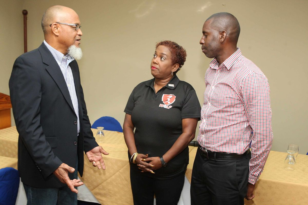Keith Look Loy, left, president of the T&T Super League addresses the media while flanked by Northern Football Association general secretary, former national youth goalkeeper Rayshawn Mars, right, and then Women's League of Football (WoLF) president Susan Joseph-Warrick at Normandie Hotel, St Ann's, in June 2019. Jospeh-Warrick resigned as WoLF president and as TTFA second vice president in November 2019.  Photo: ANTHONY HARRIS