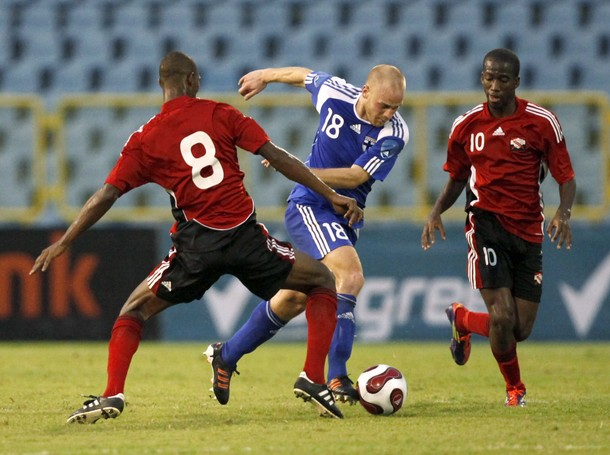 Daniel Sjolund of Finland being double team by T&T's #8 Guerra and #10 Molino