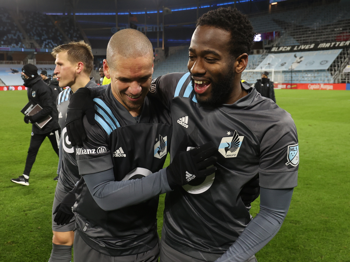 Kevin Molino (right) and Osvaldo Alonso (left) celebrate Minnesota United's 3-0 victory over Colorado Rapids on November 22nd 2020