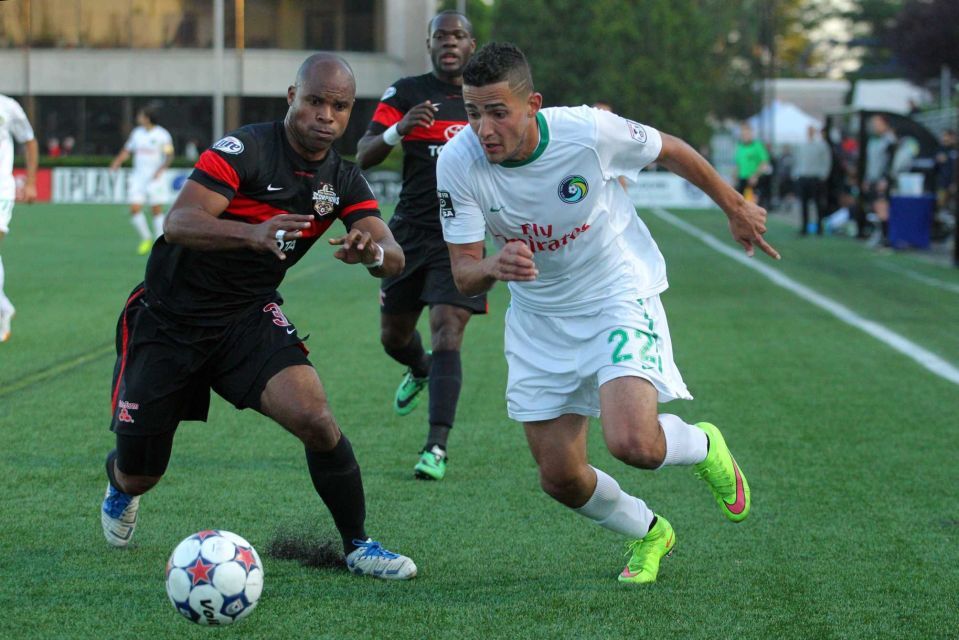 San Antonio Scorpions defender Julius James #3 and New York Cosmos midfielder Leo Fernandes #22 fight for the ball during the first half of a game at Hofstra University's James M. Shuart Stadium on Saturday, May 23, 2015. (Credit: Brad Penner)
